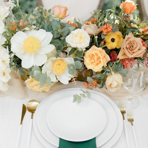 Elegant orange and green wedding tablescape