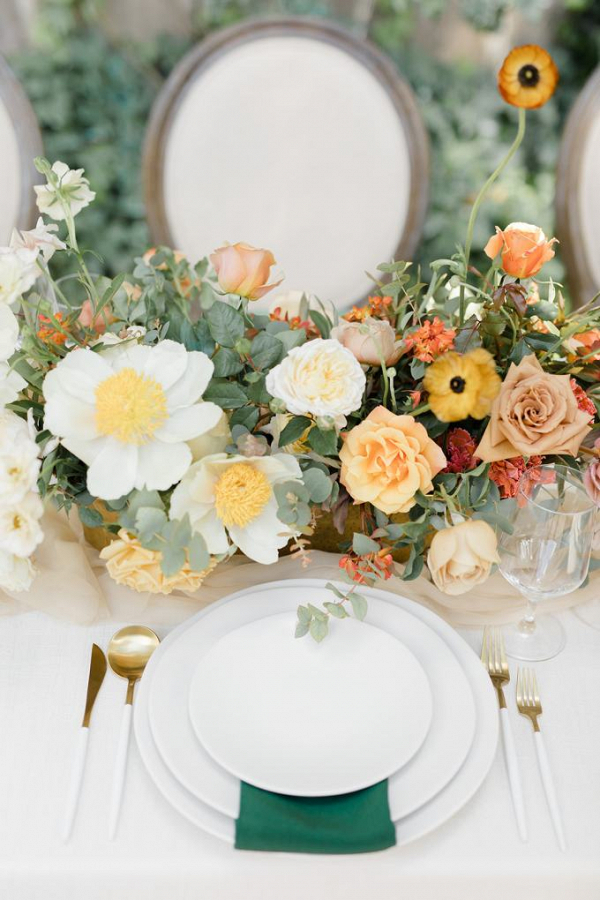 Elegant orange and green wedding tablescape