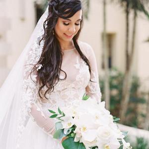 Romantic bride with white orchid bouquet