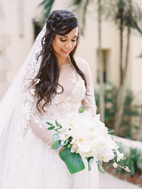 Romantic bride with white orchid bouquet