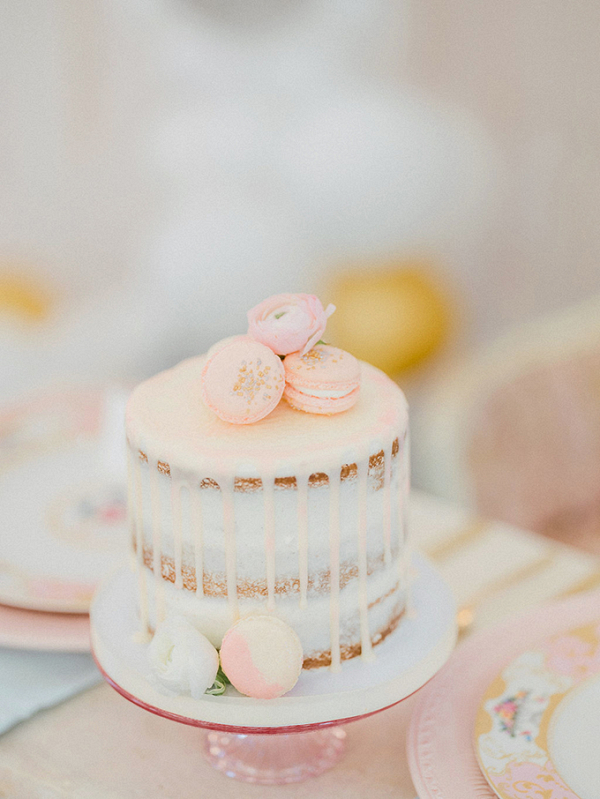 Pink drip cake with macaron topper