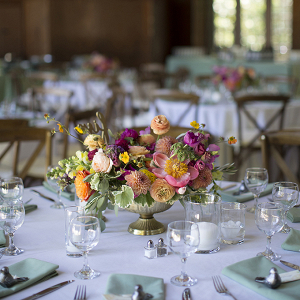 Peach, purple, and sage floral centerpiece