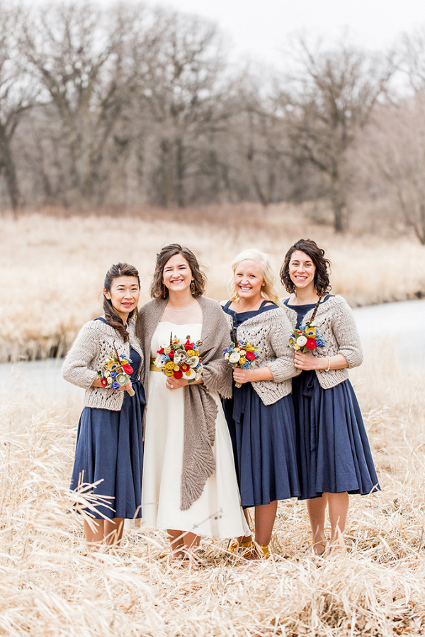 Bridesmaids in wraps with felt flower bouquets