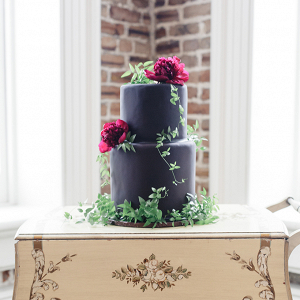Black wedding cake with fresh florals