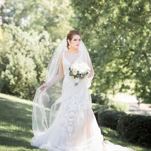 Bride in lace dress and cathedral veil