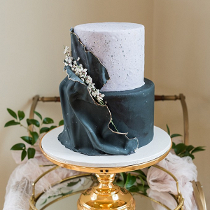 Elegant draped wedding cake