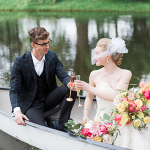 Vintage bride and groom in canoe