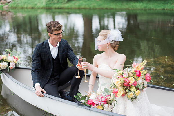 Vintage bride and groom in canoe