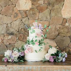 Wedding cake with purple and pink florals
