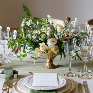 Romantic peach and sage wedding tablescape