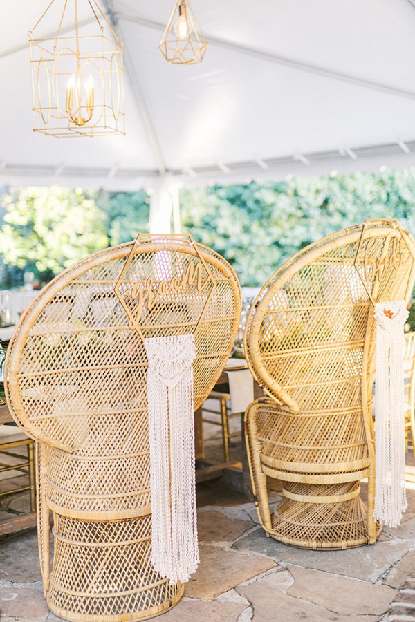 Peacock chairs with bride and groom macrame signs