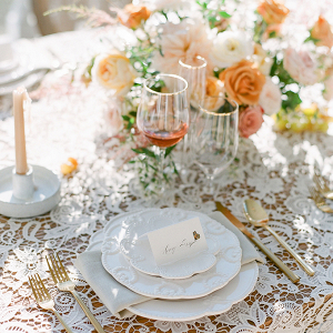 Romantic peach wedding table with lace linens