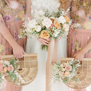 Bridesmaids with rattan purse bouquets