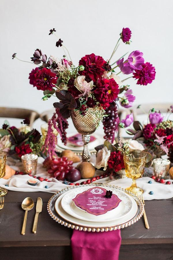 Lush burgundy wedding tablescape