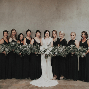 Bridesmaids in long black dresses