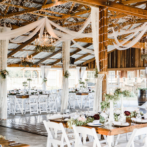 Barn wedding with draping and string lights