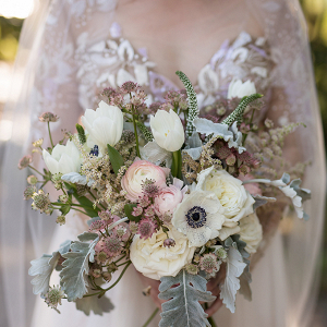 Bride in Hayley Paige gown with blush bouquet