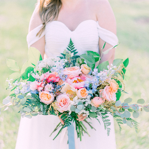 Pink, peach, and blue bridal bouquet
