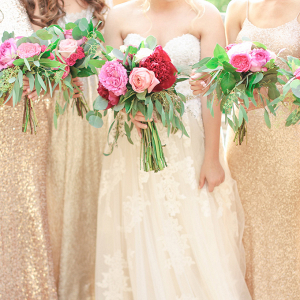 Bridesmaids in mismatched gold sequin and lace dresses
