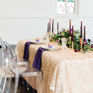 Romantic sweetheart table with gold lace overlay
