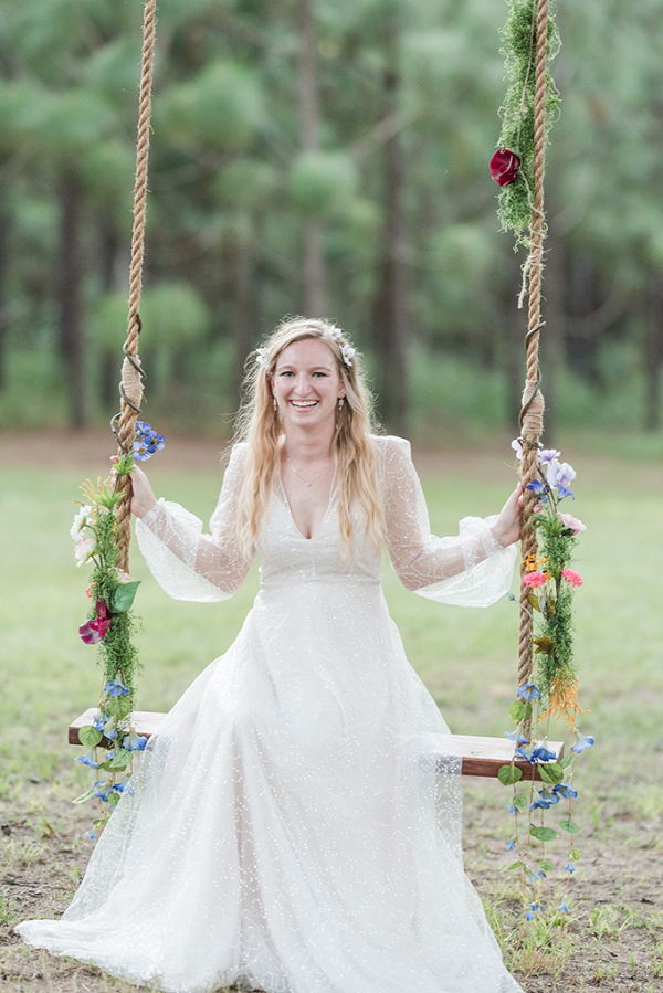 Bride on floral covered swing
