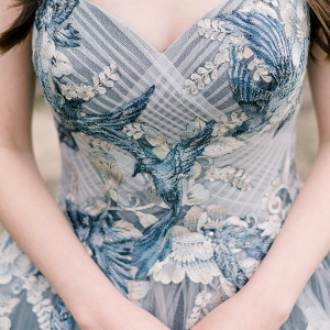 wedding dress with blue-jay appliques