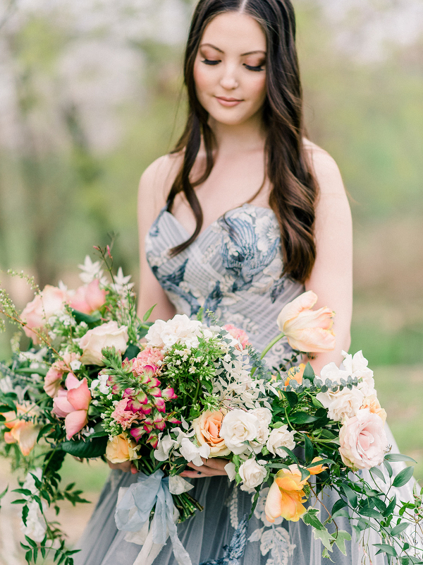 bride holding a large and colorful bouquet
