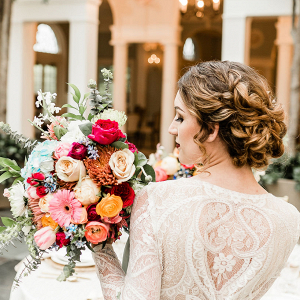 bride holding a colorful baroque bouquet