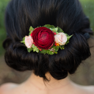 Bridal up-do with red and pink roses