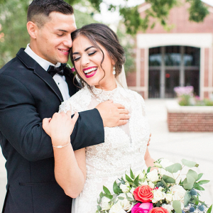 pretty bride with pink lipstick holding a large bouquet