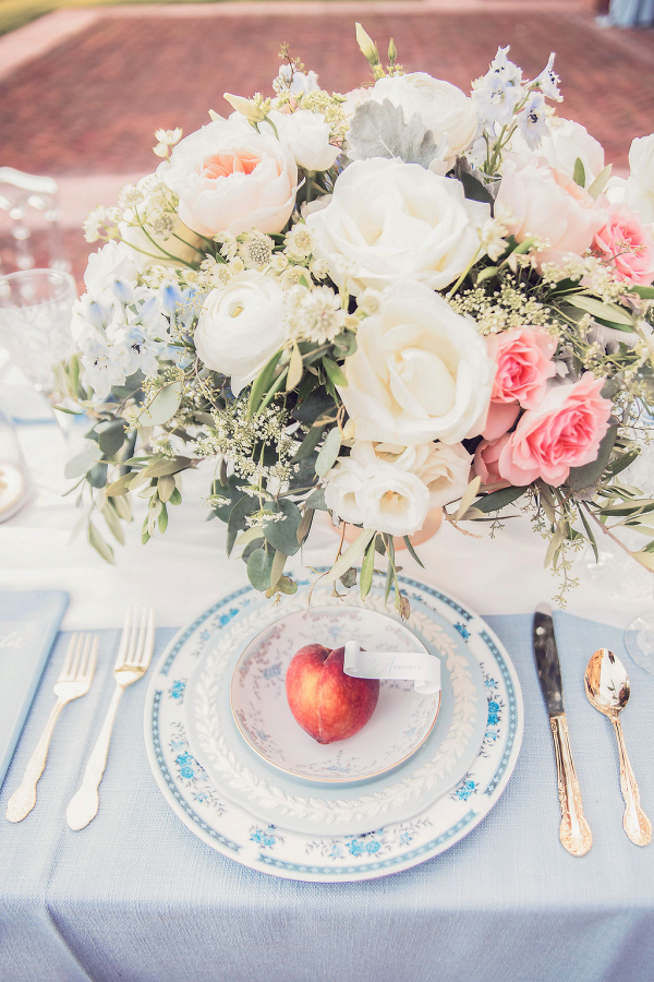 fine china place setting with a peach