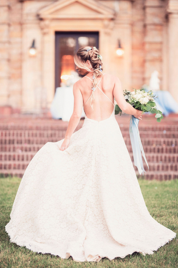 bride with open back wedding gown on Connecticut estate