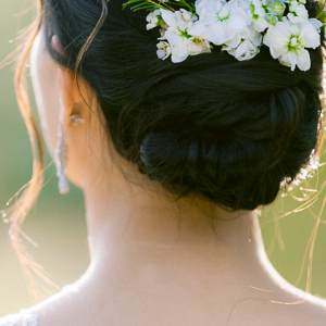 Bride with white floral hair comb