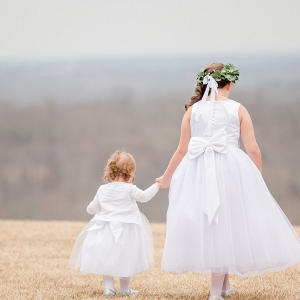 two flower girls holding hands