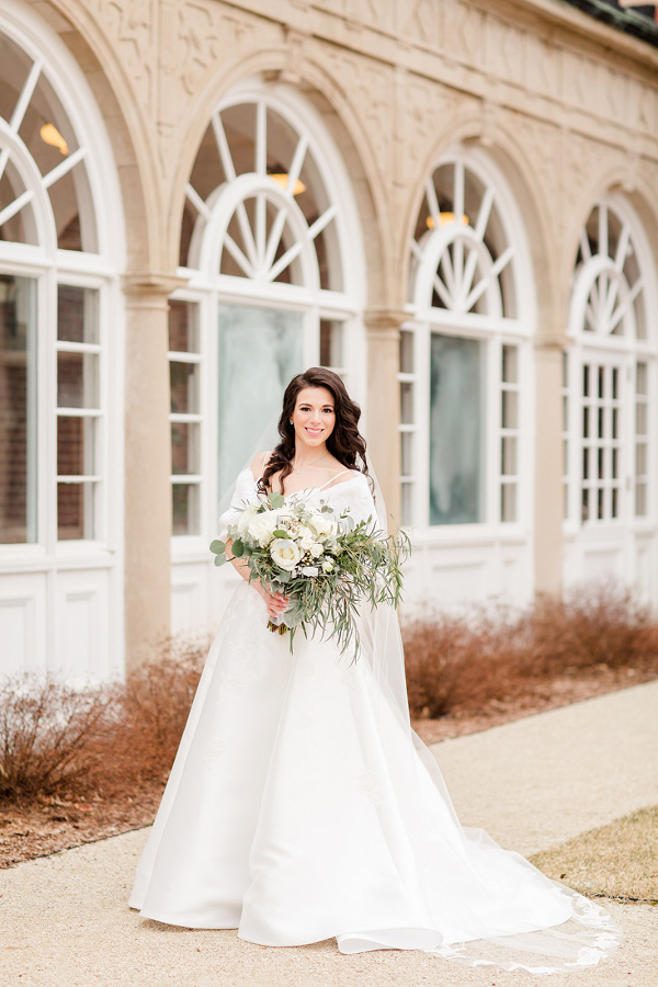 Bride holding a white rose bouquet