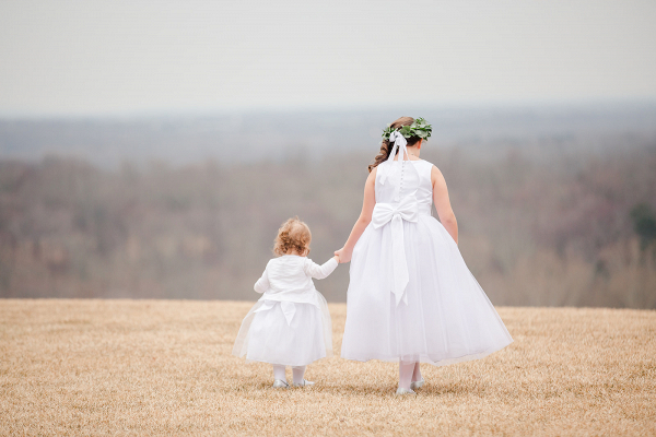 two flower girls holding hands