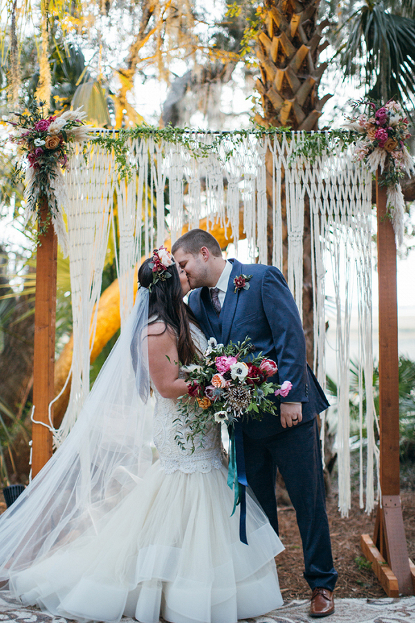 Bohemian Macrame Wedding Ceremony Backdrop with Colorful Fall Flowers