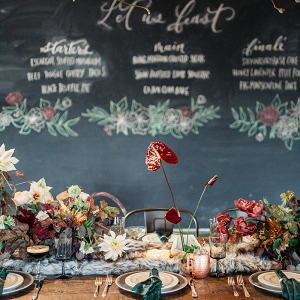 Industrial Wedding Reception with a Chalkboard Menu and Hanging Greenery