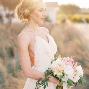 Blush Ruffled Wedding Dress with a Halter Neckline