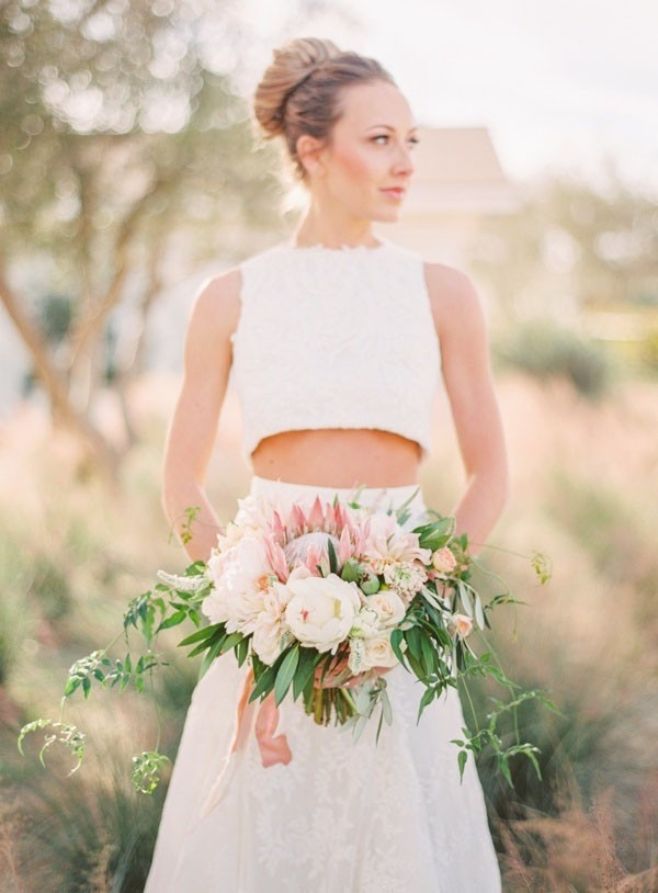 Stylish Modern Bride in a Crop Top Wedding Dress and Ballerina Bun