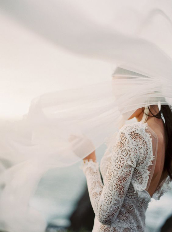 Long Sleeve Wedding Dress with a Low Back and an Ethereal Veil