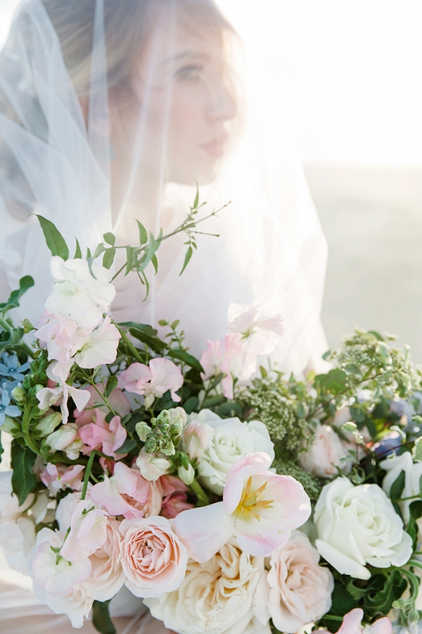 Ethereal Veiled Bridal Photos with a Pastel Bouquet