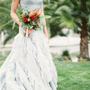 Ruffled Dusty Blue Wedding Dress with a Colorful Bouquet