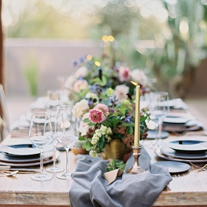 Farm Table with Colorful Flowers and Metallic Decor