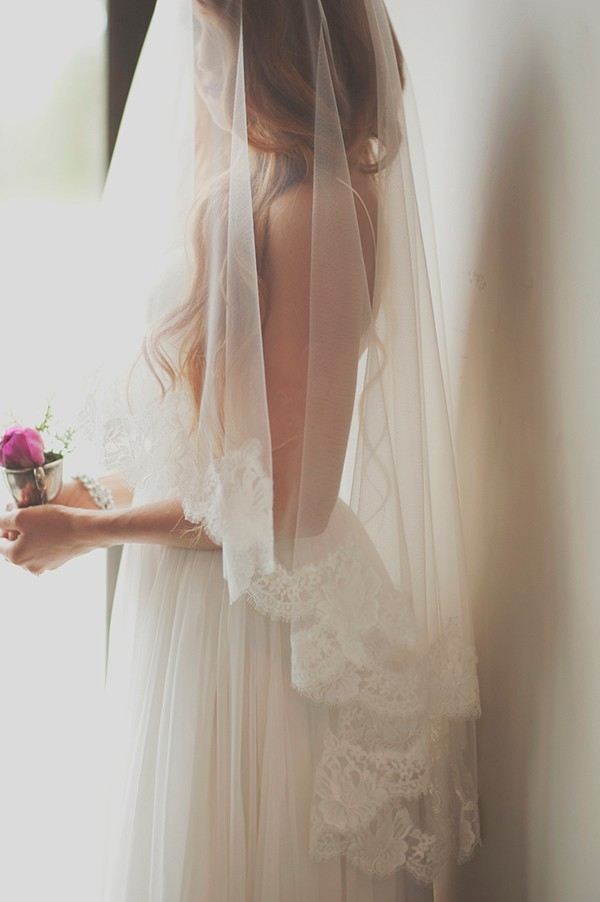 Dreamy Bride with a Lace Trimmed Veil