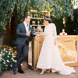 Bride and Groom Raising a Toast with Vintage Champagne Coupes