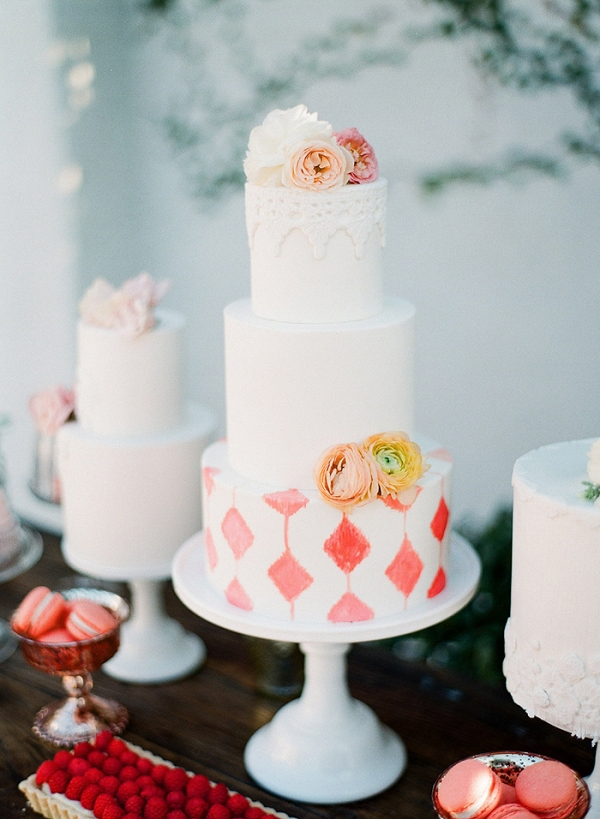 Coral and White Patterned Wedding Cake Display