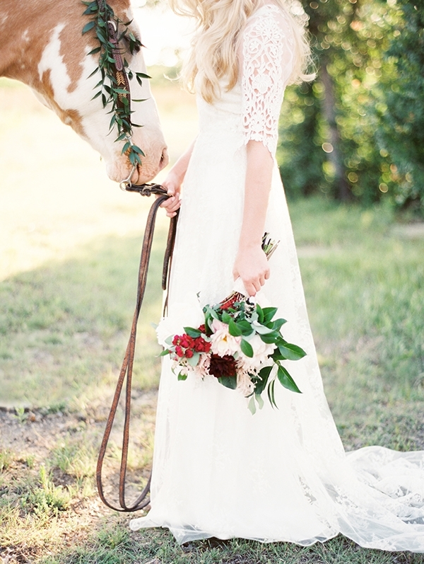 Stunning Country Bride in a Lace Wedding Dress with a Horse
