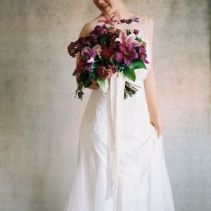 Romantic Wedding Dress and a Rich Purple Bridal Bouquet
