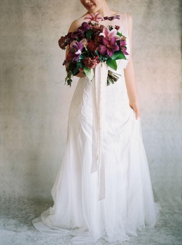 Romantic Wedding Dress and a Rich Purple Bridal Bouquet